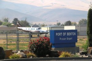 Prosser Airport sign with plane in background
